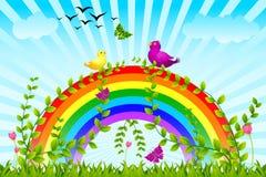 Birds sitting on colorful rainbow Stock Photo