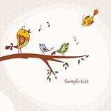 Birds sitting on a tree branch. Illustration of Birds Singing perched on a branch of a tree Stock Photo