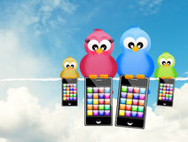 Birds with smartphones Royalty Free Stock Images