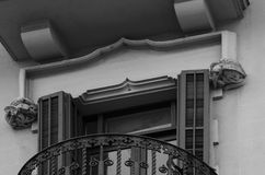 Birds standing beside the window on the capitals. Shot in black and white detail on the sculpture on the facade of this historic building representing some Royalty Free Stock Image