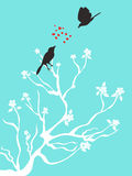 Birds talk love. Two birds talk love on blue background Royalty Free Stock Photography