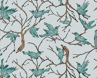Birds on tree branches with pastel blue background. Seamless repeat. Royalty Free Stock Photo