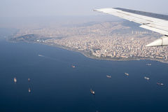Birds view of cargo ships and Istanbul, Turkey Royalty Free Stock Images
