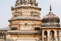 Birds on the vintage design stone towers of temple Royalty Free Stock Photos