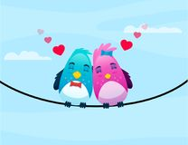 Birds on wire in love hugs each other. Royalty Free Stock Image