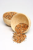 Birdseed in basket Royalty Free Stock Images