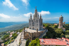 Birdview on church. Bird view on Tibidabo church on mountain in Barcelona with christ statue overviewing the city Stock Image