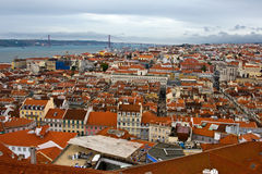 Birdview of Lisbon, Portugal. View of the Lisbon from the top, rustic tiled roofs, districts and bridges Stock Photo