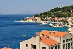 Birdview of Podgora with port and Seagull's wings Stock Image