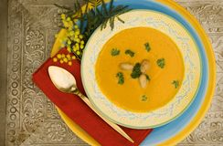 Birdview Pumpkin soup. Sweet and creamy pumpkin soup in warm colorful display Royalty Free Stock Photography