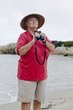 Birdwatcher with binoculars Royalty Free Stock Image