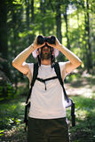 Birdwatching. Man  birdwatching with binoculars in summer  day Royalty Free Stock Images