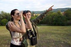 Birdwatching with binoculars Stock Photo
