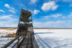 Birdwatching tower. In preservation of nature - Winter landscape Royalty Free Stock Photo