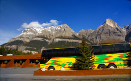 Birght yellow tour bus Royalty Free Stock Images