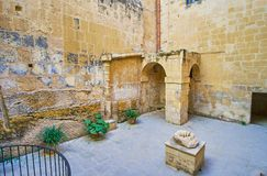 The courtyard of Inquisitor`s Palace, Birgu, Malta. BIRGU, MALTA - JUNE 17, 2018: The small medieval courtyard of Inquisitor`s Palace, on June 17 in Birgu Royalty Free Stock Photography