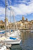 BIRGU, MALTA - MARCH 9, 2018: Birgu waterfront marina in front of Our Lady of Annunciation Church, St. Dominic`s Church. BIRGU, MALTA - MARCH 9, 2018: Birgu Royalty Free Stock Photos