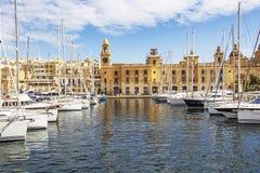 BIRGU, MALTA - MARCH 9, 2018: The Birgu waterfront marina in front of the Maritime Museum stock image