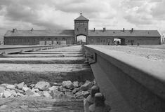 Birkenau - entry gate. Main entrance to Auschwitz Birkenau Concentration Camp Stock Photo