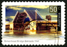 Birkenhead Bridge in Adelaide Australian Postage Stamp. AUSTRALIA - CIRCA 2004: A used postage stamp from Australia, depicting an image of Birkenhead Bridge in royalty free stock photography