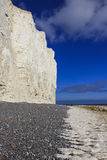 Birling Gap. EAST SUSSEX, UK - JUNE 9, 2013: The chalk cliffs and pebble beach of royalty free stock photos