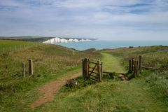 Birling Gap and the Seven Sisters. Looking towards Cuckmere Haven on the Vanguard Way public footpath with Birling Gap and the Seven Sisters in the distance Royalty Free Stock Image