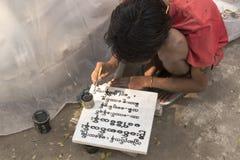 Birmańskiego lokalnego writing stara inskrypcja na marmuru bloku, Mandalay, Birma Fotografia Stock