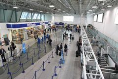 Birmingham Airport, UK. BIRMINGHAM, UK - APRIL 24: Travelers queue on April 24, 2013 at Birmingham International Airport, UK. With 8.9 million travelers served Royalty Free Stock Photo