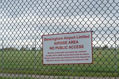 BIRMINGHAM INTERNATIONAL AIRPORT, BIRMINGHAM, UNITED KINGDOM - OCTOBER 28, 2017: fence sorrounding the airfield with. BIRMINGHAM INTERNATIONAL AIRPORT Royalty Free Stock Photo