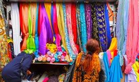 Birmingham's famous rag market. Woman shopping for fabric at Birmigham's famous rag market, England Stock Images