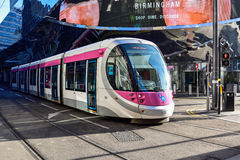 Birmingham Tram,UK. The new Birmingham city centre tram running past the new street station Royalty Free Stock Photo