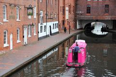 Birmingham UK. BIRMINGHAM, UK - APRIL 24, 2013: People ride a boat in the canal network in Birmingham, UK. Birmingham is the most populous British city outside stock photography