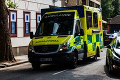 BIRMINGHAM, UK - March 2018 Ambulance Van Roving the Busy London Street. Yellow Vehicle Ready On Call for Emergency royalty free stock images