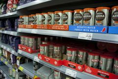 BIRMINGHAM, UK - March 2018 ASDA Angle View of Decaf and Espresso Coffee on Shelves. Products Arranged in Boxes royalty free stock photography