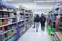 BIRMINGHAM, UK - March 2018 ASDA Customers in the Beverage Aisle Section of Supermarket. Bottled Drinks, in Can, Tetra stock images