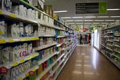 BIRMINGHAM, UK - March 2018 ASDA Inside Aisle of Toiletries in Supermarket. People Shopping for Personal Items. Section stock photos