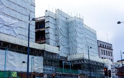 BIRMINGHAM, UK - March 2018 Building Construction Covered with White Cloth for Protection. Unfinished High Rise royalty free stock photos
