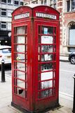 BIRMINGHAM, UK - March 2018 Rusty and Weathered Red Vintage Telephone Booth Standing in the City Street. Common London stock image