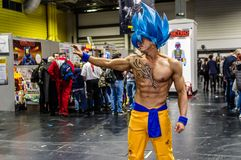 Cosplay as character from Dragon Ball. Birmingham, UK - November 18, 2017: Cosplayer dressed as Goku in his Supersaiyen Blue form from Dragon Ball at Birmingham Royalty Free Stock Images