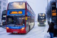 Heavy snow in Birmingham, United Kingdom. Birmingham, United Kingdom - March 02 2018 : Public transport bus during heavy snow in Birmingham, United Kingdom royalty free stock images