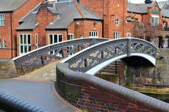 Birmingham. Water canal network - steel footbridge. West Midlands, England royalty free stock photography