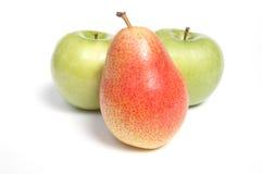 Birne und zwei Äpfel Stockfotografie
