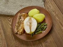 Birnen, Bohnen und Speck. Pears, beans and bacon, North German dish which is especially popular in the states of Schleswig-Holstein, Lower Saxony, Mecklenburg stock photo