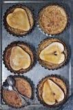 Birnen- und Vanillevanillepuddingtörtchen Stockfotografie