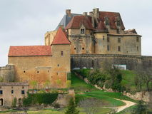 Biron (France ). View of the Biron castle in spring Royalty Free Stock Photos