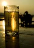 Birra al tramonto Fotografia Stock