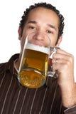 Birra bevente Immagini Stock