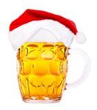 Birra e cappello di Santa Claus Fotografia Stock