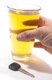 Birra e chiave Immagine Stock
