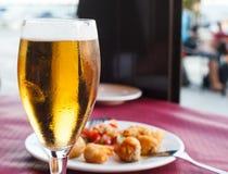Birra e tapas Fotografia Stock